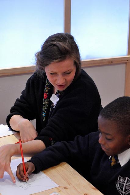 Volunteer Helping Student