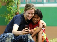 Volunteer Posing with Child
