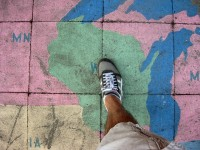 Person Stepping on Chalk Map